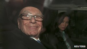 Rupert Murdoch being driven away after giving evidence to the Leveson Inquiry