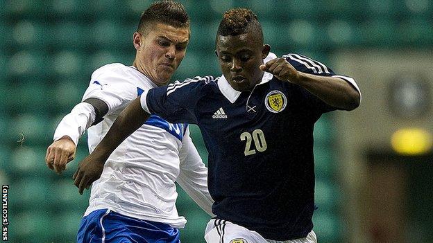 Scotland debutant Islam Feruz makes his way past Federico Viviani (left)
