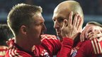 Arjen Robben (right) of Bayern Munich celebrates scoring from the penalty spot with Bastian Schweinsteiger
