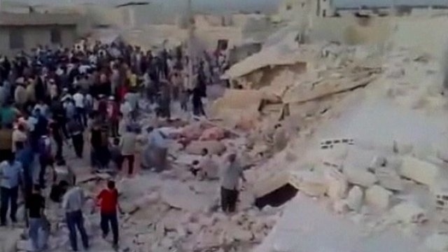 Crowds helped rescue people in the rubble following a huge explosion in Hama