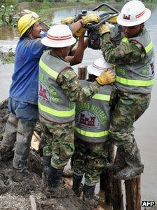 Army engineers work to repair a collapsed river dam in Cota, near Bogota