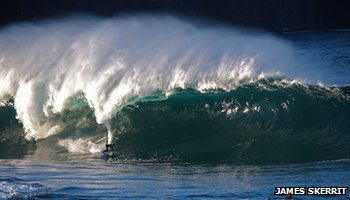 Surfer riding big wave Mullaghmore