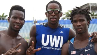 Jehue Gordon with Brandon Benjamin (l) and Josiah Burkett (r)