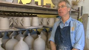 Mike Fletcher in front of pottery