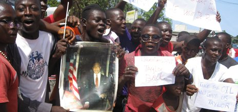 A parade of Charles Taylor's supporters in Monrovia shortly before verdict was passed