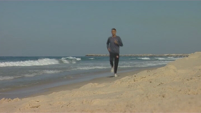 Nader el Masri running along the beach in Gaza