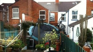 A trampoline was blown into Adam Trezise&#039;s garden during high winds