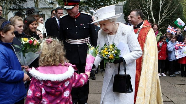 The Queen is given flowers by children in Cardiff