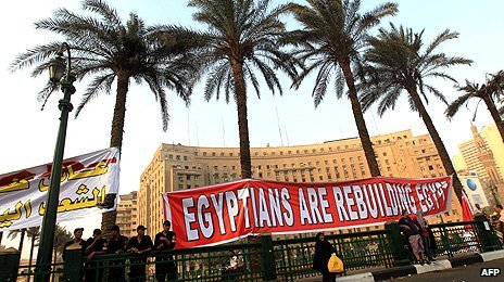 A banner in Tahrir Square reads 'Egyptians are rebuilding Egypt'