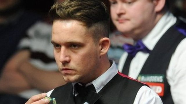 Jamie Jones lines up a shot as Shaun Murphy looks on