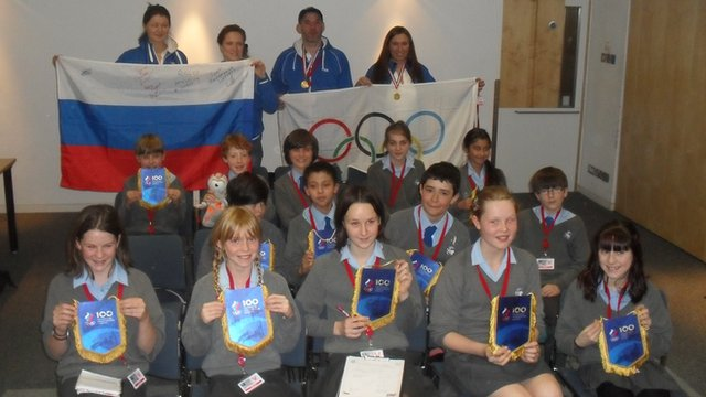 Students from Fairlands Middle School pose with Russian Olympic hopefuls