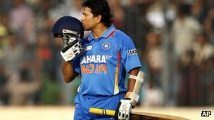 Sachin Tendulkar kisses his helmet after scoring his 100th century - 16 March 2012