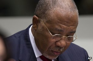 Former Liberian President Charles Taylor looks down in the courtroom of the Special Court for Sierra Leone in The Hague