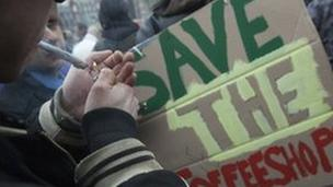 Protestor lights marijuana joint, Amsterdam 20 April 2012