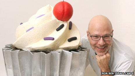 Ron Ben-Israel with a giant cupcake