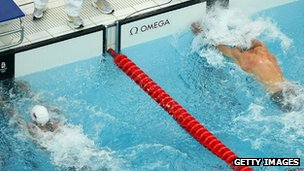 Milorad Cavic of Serbia (left) and Michael Phelps of the United States complete the men's 100m Butterfly final at Beijing 2008 in China