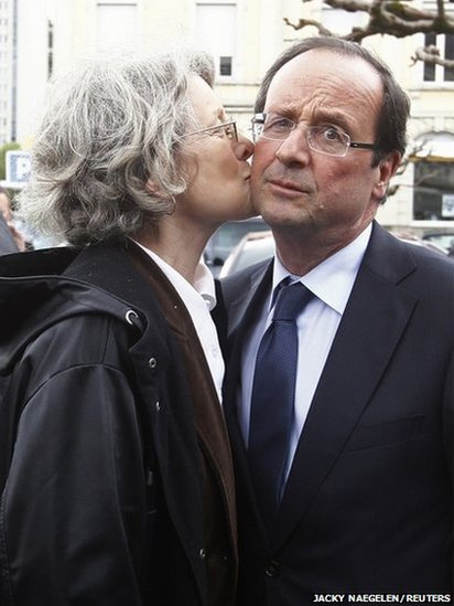 Francois Hollande is kissed by a supporter in Tulle, France, 21 April 2012