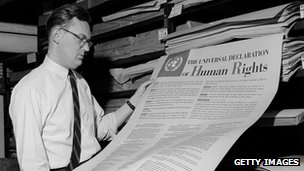 A man looks at one of the first documents published by the United Nations, The Universal Declaration of Human Rights, in 1955