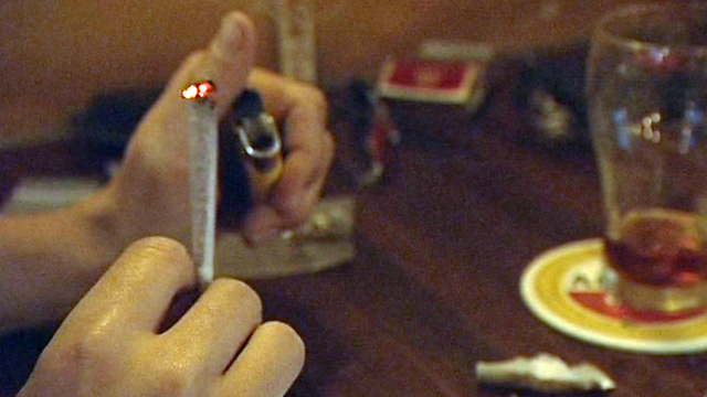 Cannabis joint being lit in coffee shop