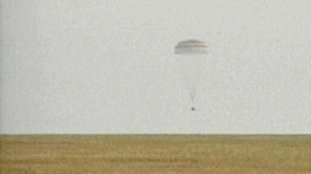Soyuz capsule parachutes down to ground