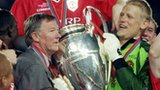 Peter Schmeichel lifts the Champions League trophy