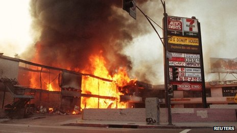 A shopping centre in Korea Town, Los Angeles, burning during the riots, 1 May 1992