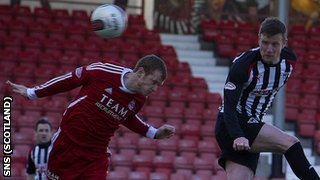 Andy Kirk leaps above Mark Reynolds to score a header for Dunfermline against Aberdeen