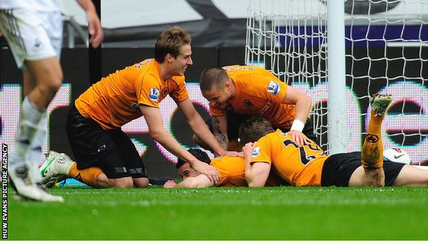 Goal-scorer Matt Jarvis is mobbed by his Wolves team-mates
