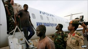 Detained men arrive in Khartoum for questioning. Photo: April 2012