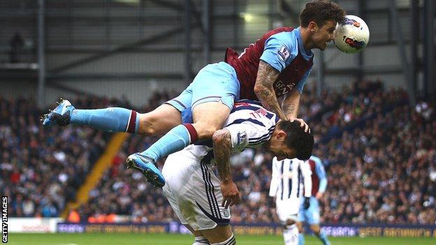 Aston Villa's Chris Herd challenges West Brom's Liam Ridgewell