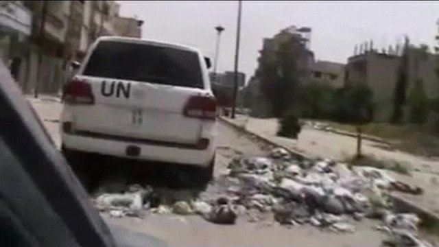 Video purporting to show UN monitors touring a devastated Homs neighbourhood on April 28