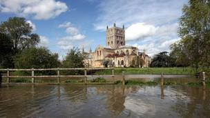 Floodwaters rise around Tewkesbury Abbey