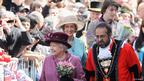 Queen Elizabeth II undertakes a walkabout in Windsor on April 30, 2012 in Windsor, England