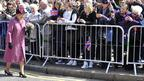 Queen Elizabeth greets well-wishers as she takes part in a walkabout from Windsor Castle to the Guildhall in Windsor