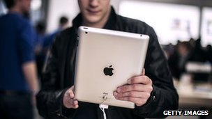 A man holds the latest Apple iPad