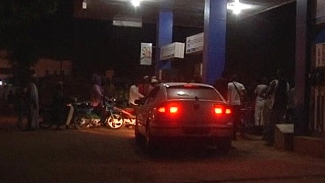 People gathering at a service station