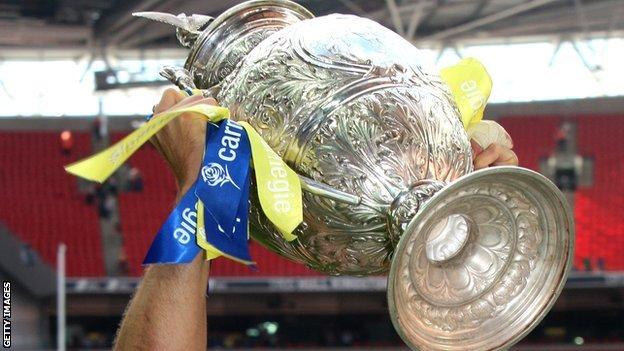 Carnegie Challenge Cup held aloft
