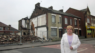 Maureen Walsh outside her house