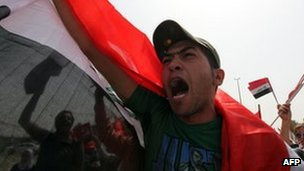 A supporter of the Iraqi Communist Party shouts slogans during a march to Firdous Square, in the centre of Baghdad, 1 May