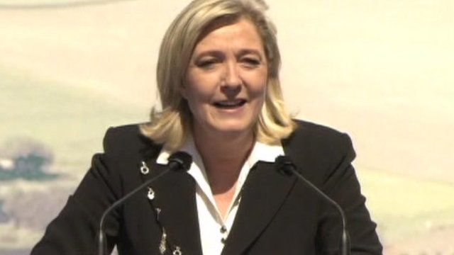 National Front leader Marine Le Pen addresses a rally on May Day