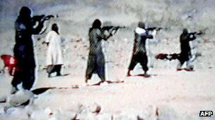 A video grab dated 19 June 2001 shows al-Qaeda recruits firing weapons at an Afghan training camp