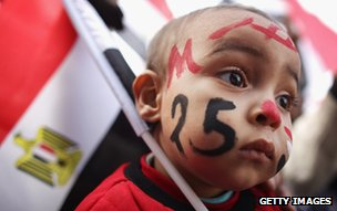 A young child with his face painted as Egyptians mark first anniversary of the revolution in Cairo, Egypt, on 25 January 2012