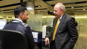 Immigration Minister Damian Green on a visit to Terminal 3 of Heathrow Airport