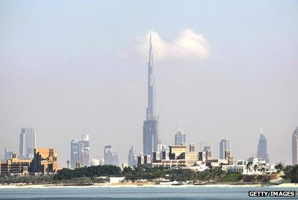 The Dubai skyline. The Burj Khalifa stands prominently in the centre, reaching into the sky.