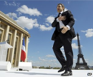 Nicolas Sarkozy arrives for his open-air speech in Paris, 1 May