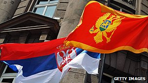 Flags of Serbia, left, and Montenegro