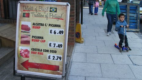 Sign outside Brazilian-run butcher's in Willesden