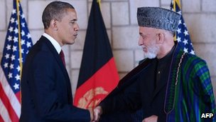 President Barack Obama shakes hands with Afghan President Hamid Karzai
