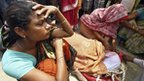 Unidentified women weep next to the body of a victim of a boat that sank in India's Brahmaputra river, at Buraburi village in Dhubri district of the northeastern Indian state of Assam May 1, 2012.