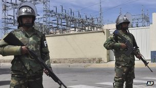 Military police stand guard outside TDE in Cochabamba